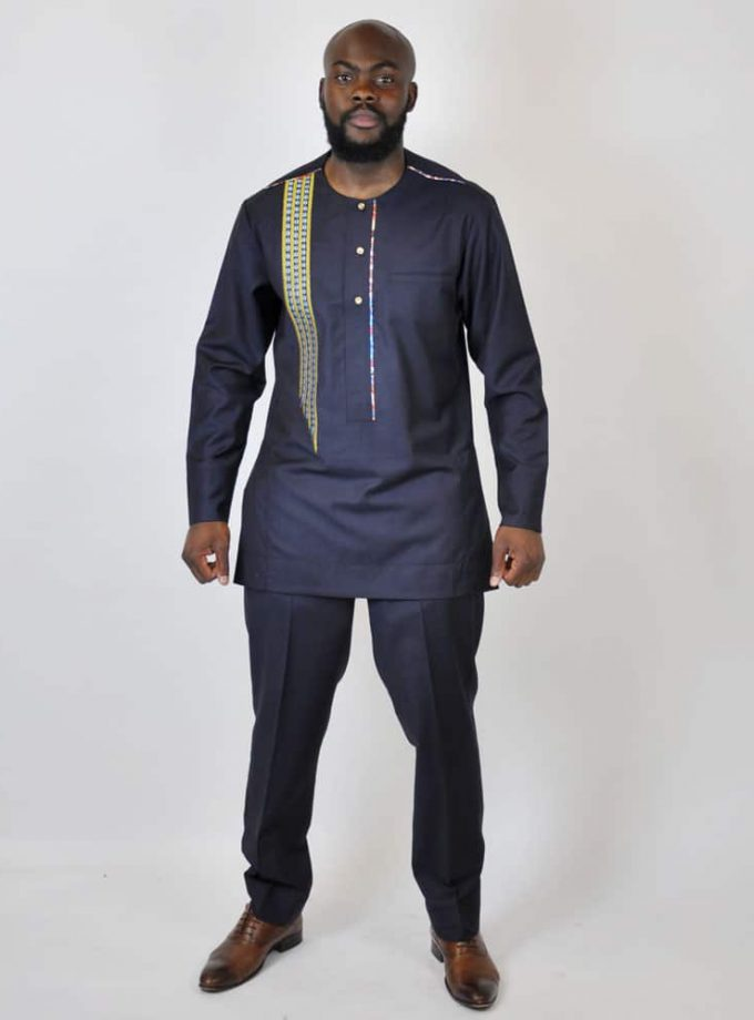 Full frontal of model wearing our men's authentic and traditional African suit in blue.