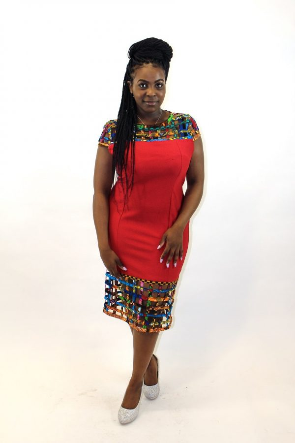 Full frontal of model wearing our solid red bodycon dress with mesh detail in African print.