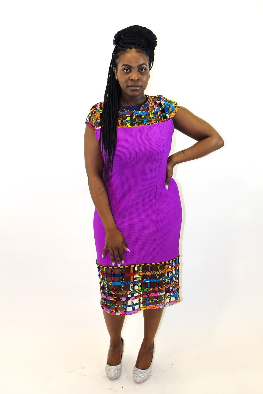 Full frontal of model wearing our solid purple bodycon dress with mesh detail in African print.