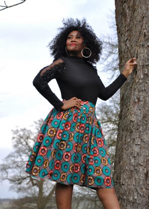 Multi-Coloured African Print Skater Skirt. Blue Cotton knee length full skirt with waistband. Features orange & pink ring pattern or African print all over.