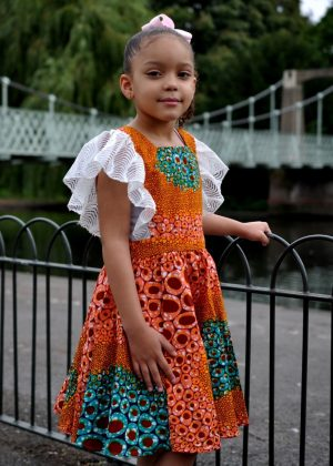 Kids size 5-7 year old occasion dress with lace around arm
