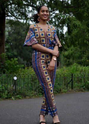 Blue & Gold African Print Cold Shoulder Jumpsuit SKU: 4236. Ladies blue & gold African print jjumpsuit features butterfly sleeves with cold shoulder design and v neckline. Perfect for any summer occasion. Dress up or down with heels or elegant flats.