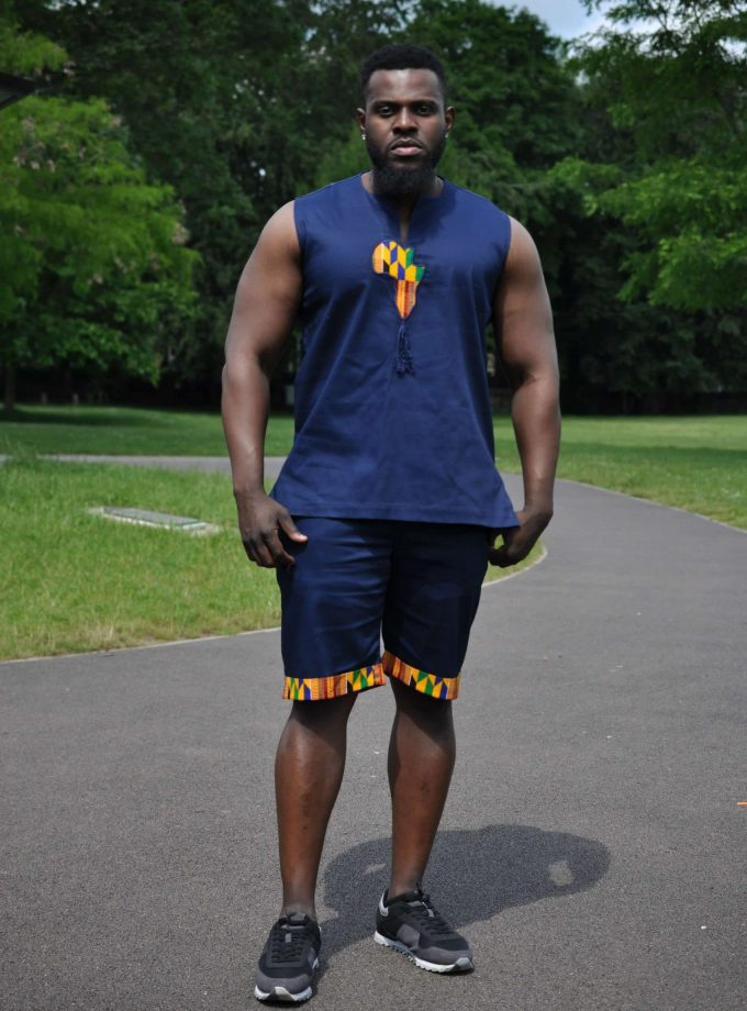 Blue & African Print Trim Short Pants Matching Set / Co-ord from African Clothing Store. Navy blue sleeveless tank top and matching shorts. Features a map of Africa in Kente print on the chest and African print trim on shorts hem and rear pocket. SKU: 19254