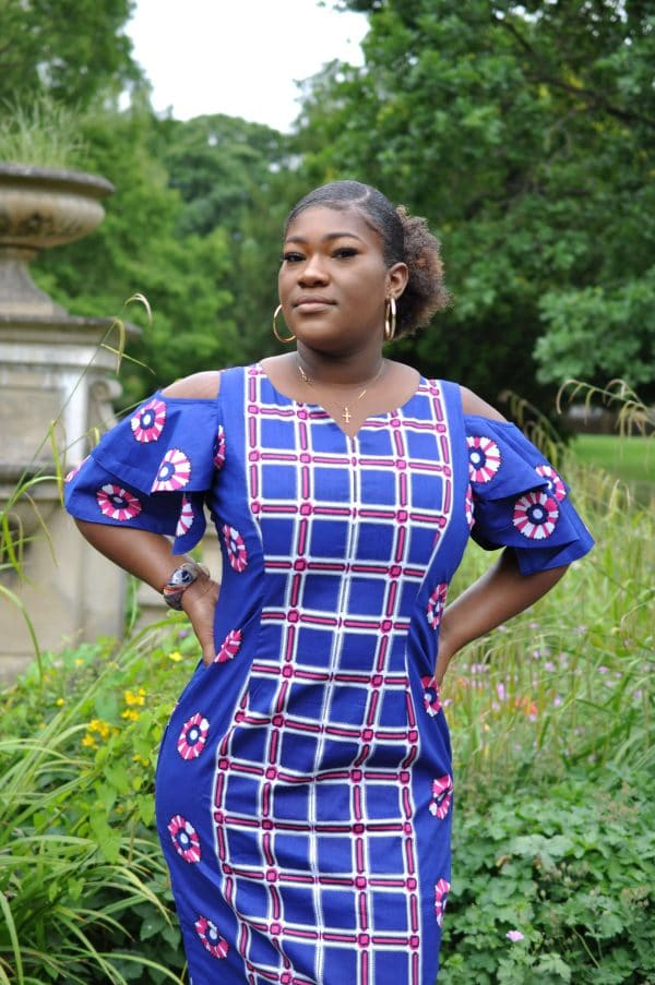 Our custom made African print midi has a mixed geometric grid pattern on front and back and records on the sides and sleeves.pattern