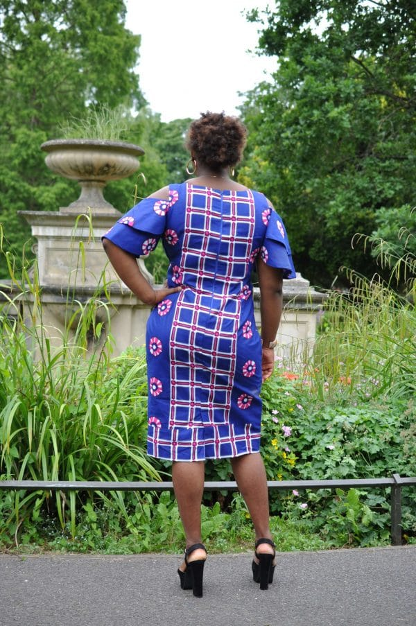 Back shot of model wearing our custom made African midi dress with a mixed geometric pattern.