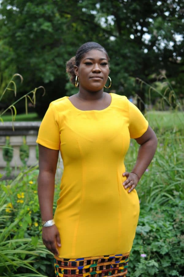 Close shot of our yellow bodycon dress with Ankara mesh hem, custom made to your shape and measurements.